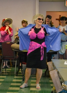 Nancy Young reveals what's under her shirt:  a braided bra and sarong wrap.  Made by Pam Rowan