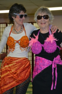 Pam Rowan and Nancy Young paraded around the room in their matching bikini tops and sarongs